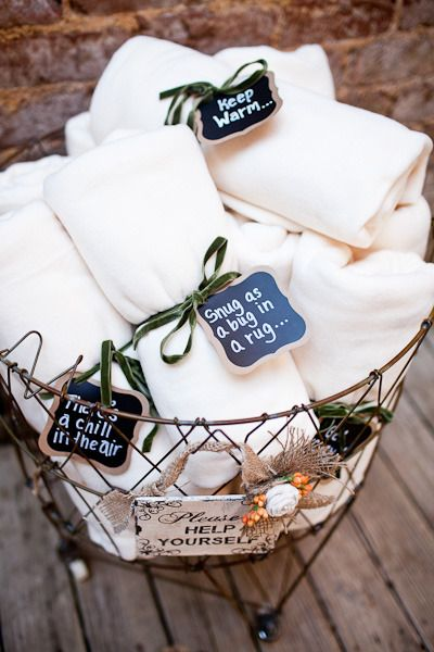 Perfect for an outdoor wedding! Blankets with cute sayings to keep your guests cozy as the sun goes down!