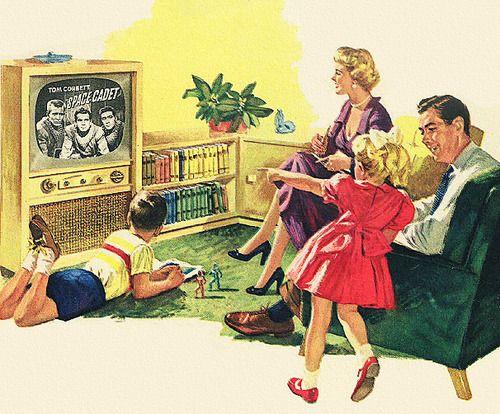 Midcentury family watching tv