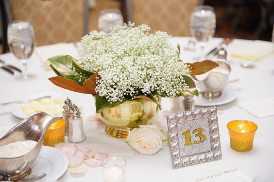 A short centerpiece with metallic details makes conversation easy! Venue at The Skirvin Hilton. Rentals by Marianne's Rentals for Special Events. Flowers by Trochta's Flowers and Garden Center. Holli B. Photography. Wedding by Amanda Sikich of Planned 2 Perfection Weddings. #wedding #winter #centerpiece #babysbreath