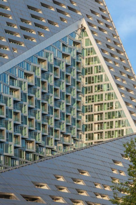 The tetrahedral New York apartment building designed by Bjarke Ingels Group is…