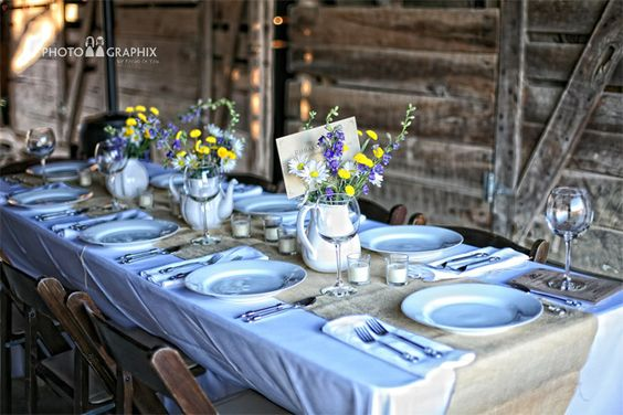 Simple tablecloths with burlap to add texture. Wildflower centerpieces with candles for ambience.