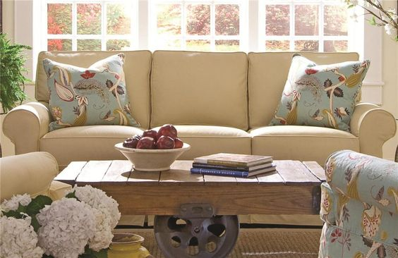 Not the sofa style- but the feel- I like something like this for the sunroom- love the coffee table.