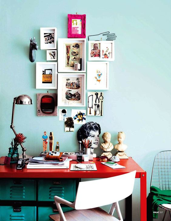 tiffany blue walls, red desk, turquoise file cabinets, fuschia frames - love the hodge podge coloring :-):