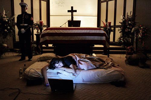 "This brings tears to my eyes every time I see it.The night before the burial of her husband, Katherine Cathey refused to leave the casket, asking to sleep next to him for the last time. The Marines made a bed for her, tucking in the sheets below the flag. Before she fell asleep, she opened her laptop computer and played songs that would have been played at a formal wedding they never held. She asked the Marines to continue standing watch. ""I think that's what he would have wanted,"" she said."