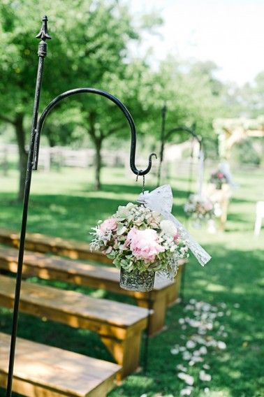 Flowers hanging from shepherd's hooks for ceremony aisle decor // Photo by http://cynkainphotography.com, see more: http://theeverylastdetail.com/rustic-chic-pennsylvania-barn-wedding/