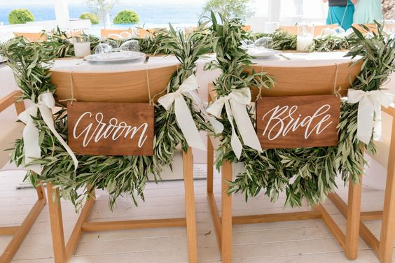 Bride & Groom chair signs with olive brunces