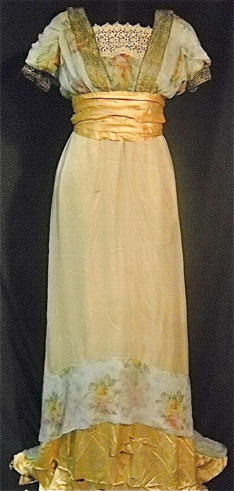 1910-1912 metallic gold trim, rose pattern silk gown, with gold satin waist and ruffle.