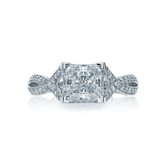 """This """"star"""" piece featuring a princess cut diamond is showcased with diamond pave; set along crisscrossing arms."""