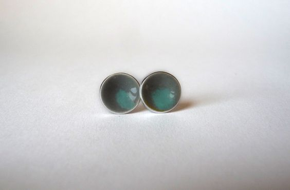 We love studs that we can leave in for days without a second thought. These Smoke & Seafoam Two Tone Color Dot Earrings by k.o'brien jewelry are going to get a lot of wear—they go with everything! Made by sifting crushed glass onto a dapped disc of fine silver.