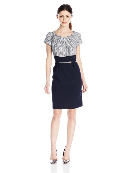 Sandra Darren Women's Petite Cap Sleeve Woven Sheath Dress with Belt, Navy/White, 14. Combo dress featuring patterned short-sleeve top with pleated neckline and solid high-waist skirt with pleats. Includes belt with hardware centerpiece. Concealed center back zipper.