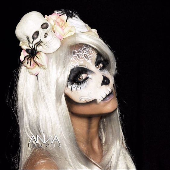 Side angle of my sugar skull makeup.... emoji Product breakdown: emoji️@nyxukcosmetics jumbo pencil in milk and @illamasqua skinbase foundation to create the skull base emoji️@nyxukcosmetics stormy skies palette for the purple brown and black shading & the lips emoji️@GlobalColours Body Art face paints in white & strong black from @thefacepaintingshop emoji️Top lashes @eldorafalseeyelashes in C188 emoji️Bottom lashes @hudabeauty in Candy emoji️Contact lenses @mesmereyezcontactlenses…