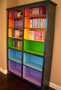 This would be really cool for a playroom. Arrange children's books into colors by age groups - red for oldest, purple for youngest. Or it'd be a nice way to brighten up school books for the homeschooler!