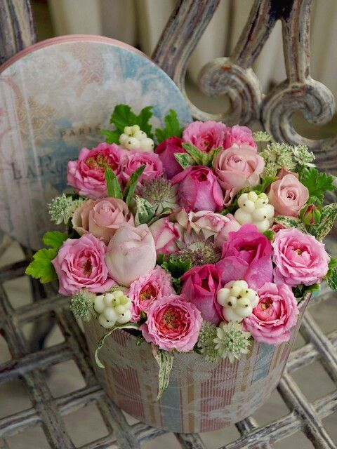 #Flower...this is such a pretty arrangement. What a clever idea to use a cake tin container.