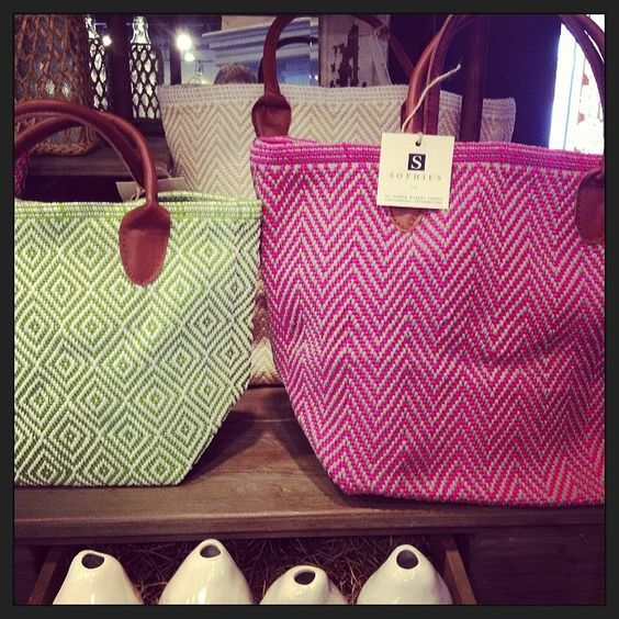 Colorful patterned totes with leather handles-- great for hauling your workout clothes or tossing in beach items!