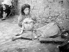 A young Jewish woman caring for a baby in a yard in Szydłowiec.