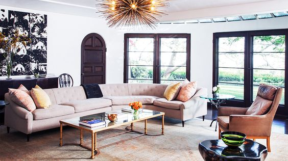 Sofas 101: The Ultimate Guide to Shopping for a Sofa // brass urchin chandelier, gold side table, leather chair, living room