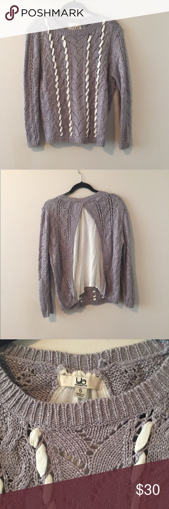 Grey sweater Grey knit sweater. Sheer material through the front and open sheer back. Thinner sweater. Worn once. No trades. Great condition. Ya Los Angeles Sweaters Crew & Scoop Necks