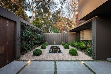 """Symmetry focuses viewer to """"here"""". Imagine opening in fence to """"there"""" Narrow Garden Design Ideas, Pictures, Remodel and Decor"""