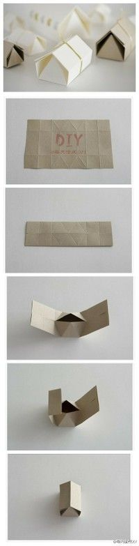 folded little house would be cute to use as place cards for a welcome home dinner or house warming. write name on outside and inside write menu items. also could fill with cheese, crackers and small grapes for a appetizer or cookies!
