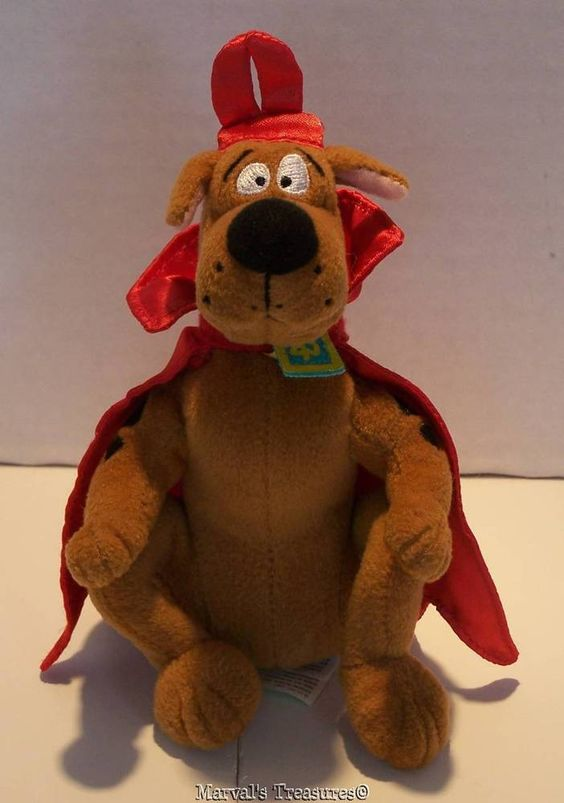 "Up for consideration is this hard to find Scooby-Doo in a devils costume. He sits 6"" tall and his horns add approx. 1/2"". He is sporting his signature SD collar and the horns and cape appear to be made from a satiny fabric. 