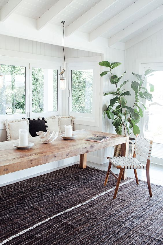 white walls + wood table + built-in bench: