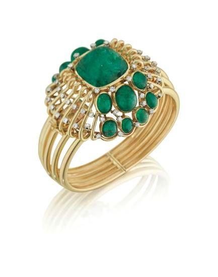 Mauboussin. A Unique Emerald, Diamond, and Gold Bracelet, 1950's