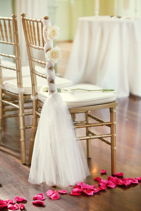 Perfect tulle wedding ceremony chair decoration.  Inexpensive too! http://www.pinterest.com/JessicaMpins/