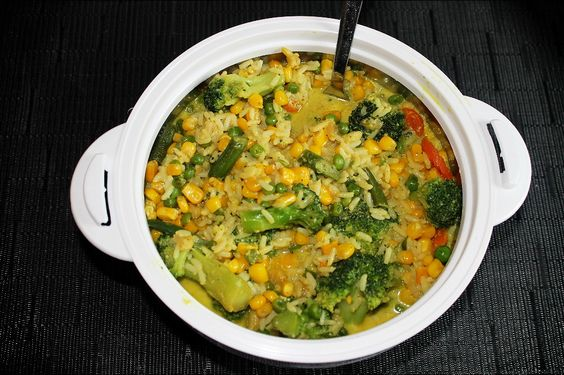 Cooked vegetables and rice with coconutmilk and curry spice.