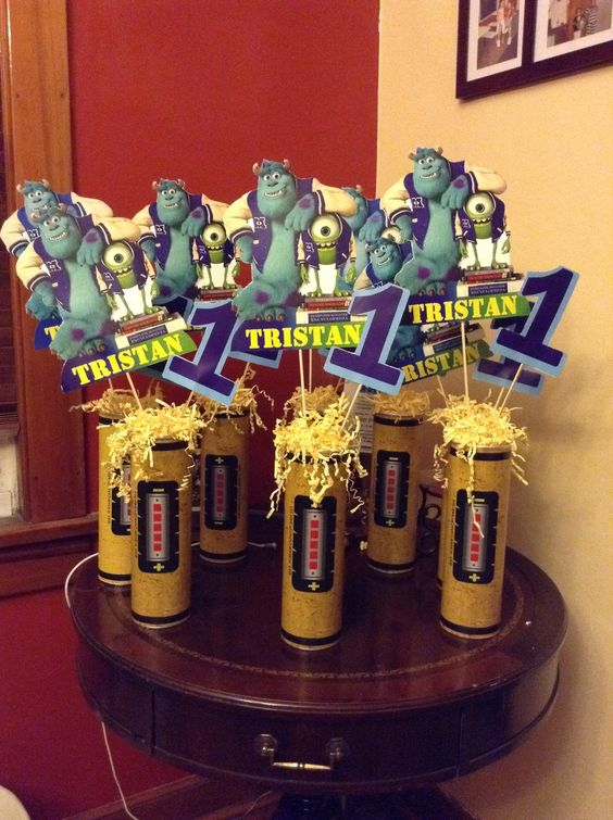 Monster University center pieces... I just finished these for my nephews birthday. I made them with Pringles cans. The printouts of Mike and  Sulley, I bought from Etsy PartiesByTristan and the canister printout from BoutiqueHeartAndSoul.