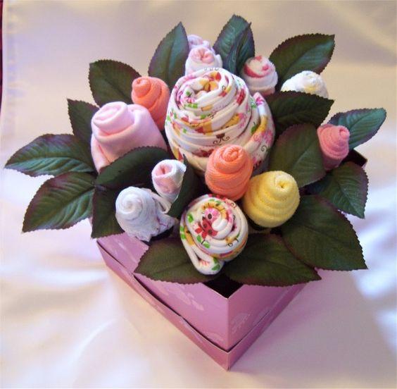 Centerpiece idea baby onesie bouquet shower