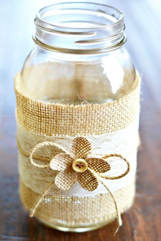 Mason jar centerpieces with burlap lace jars