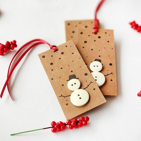 Kraft gift tags with buttons arranged as snowmen