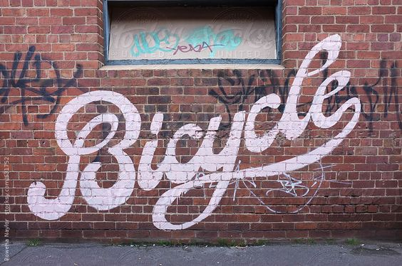 Word 'bicycle' painted on wall by rowenanaylor | Stocksy United