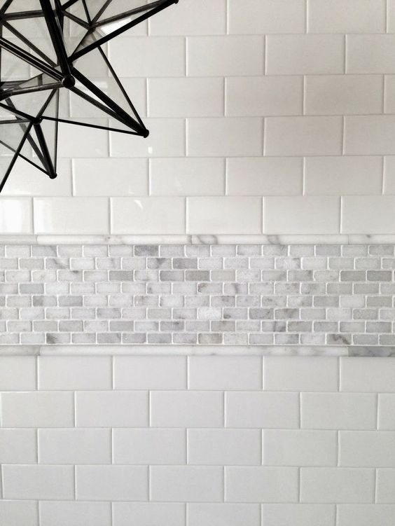 Don't be afraid of mixing materials.  This is carrara with ceramic subway tile.   The pencil helps deal with the possible thickness differences.