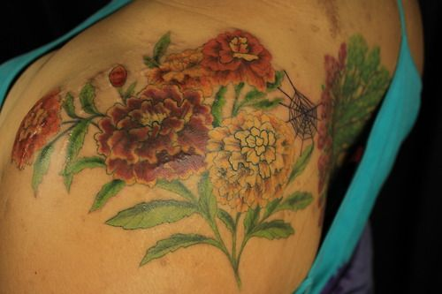 Planning to add Alexa's birth flower to my ankle tattoo of her name.