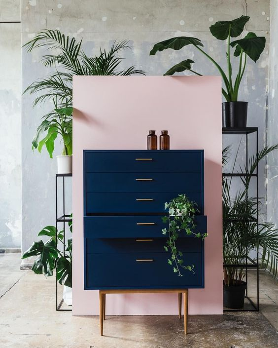 Pink wall with dark blue dresser.  Home Decor Inspiration home decor, home inspiration, furniture, lounges, decor, bedroom, decoration ideas, home furnishing, inspiring homes, decor inspiration. Modern design. Minimalist decor. White walls. Marble countertops, marble kitchen, marble table. Contemporary design. Mid-century modern design. Modern rustic. Wood accents. Subway tile. Moroccan rug. #modernhomedesigninspiration