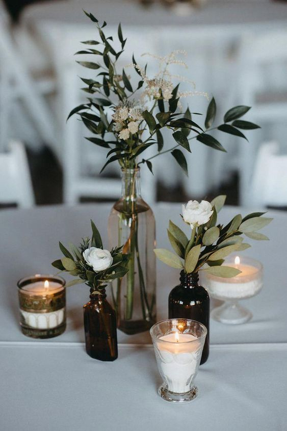 Simple DIY Wedding Decoration Idea With Mismatched Bottles And Roses