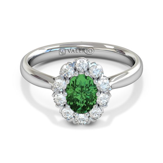 This oval cut Brazilian emerald is surrounded by traceable conflict free diamonds. A truly classic style engagement ring, that will last forever. The tapered daylight shoulder shank is available in 18ct. Fairtrade yellow, white or rose gold.