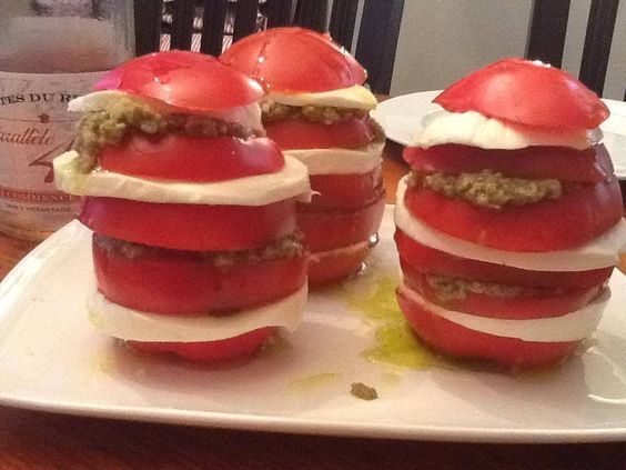 Jersey Tomatoes, fresh mozzarella, green olive tapenade drizzled with Arbequina olive oil. Yum!  Photo & Recipe credit, Fourchette.