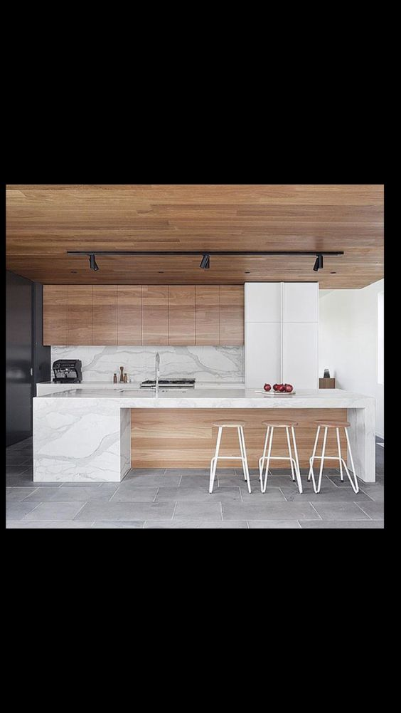 This is the marble look waterfall bench and timber veneer kitchen joinery with cedar ceiling