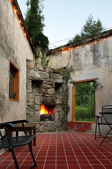Courtyards fireplaces and spanish revival on pinterest for Spanish outdoor fireplace