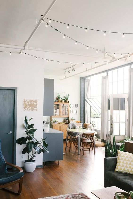 Dining room with overhead fairy lights