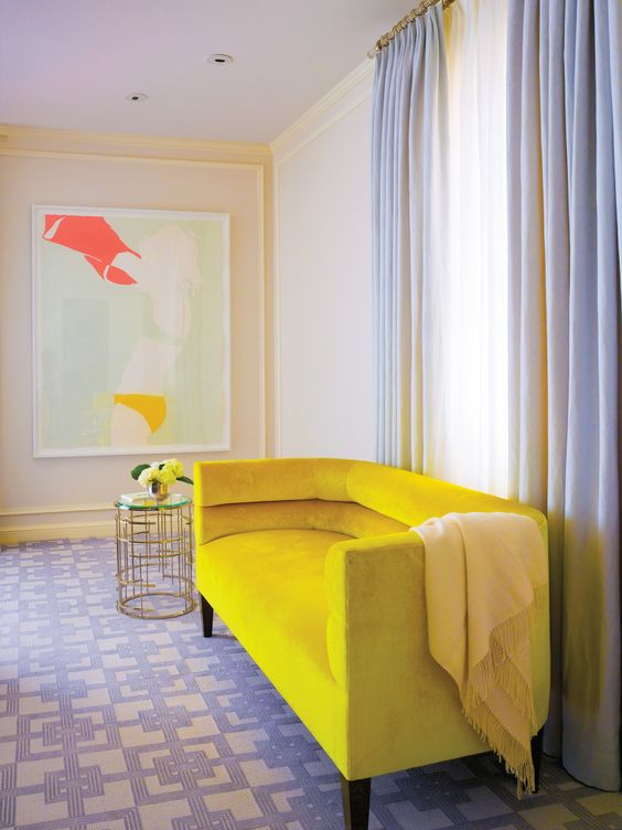 weiss adds her signature pops of color to the master bedroom including art by natasha law and a bright lemon yellow belmar co custom made settee bright yellow sofa living