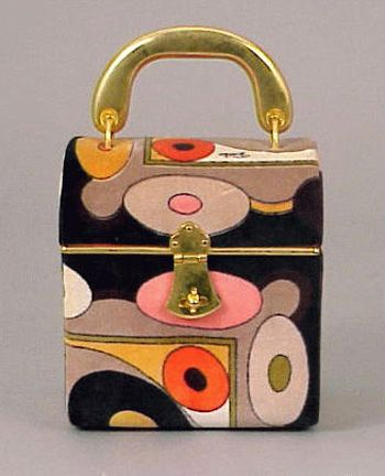 Pucci Velveteen Small Box Bag, 1960s. Casket shape, with rigid flat gilt-metal handle, suitcase lock, printed with curvilinear pattern in shades of orange, black, putty and camel, labeled: Emilio Pucci.