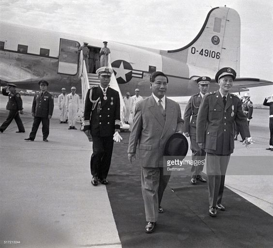 Vietnamese President Ngo Dinh Diem (front left), is greeted upon his arrival at the airport of the capital city of Taiwan by Chinese Nationalist President Chiang Kai-shek. The Vietnamese president was making an official five-day state visit to the Republic of China.