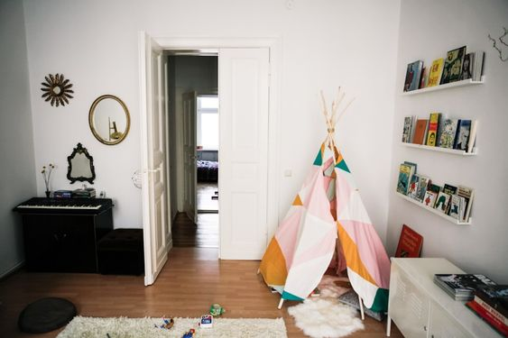 this is the perfect mix of child/adult space in a small apartment. LOVE
