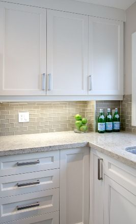 White shaker cabinets, Smoke gray glass subway tile backsplash, neutral quartz countertop