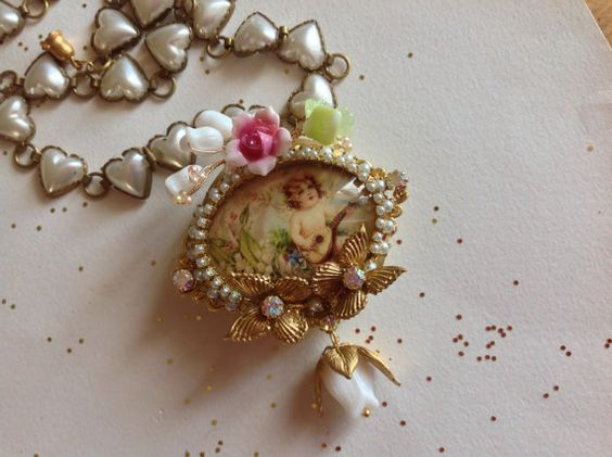 Vintage fairy  pendant , porcelain cabochon, angel playing mandolin,glass leaves and lily of the valley's buds,on wire,butterflies