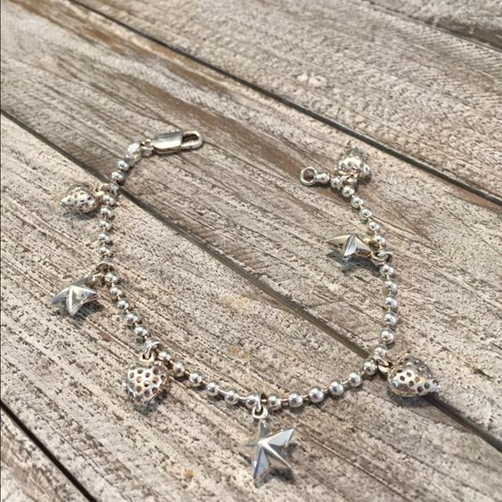 """Adorable Heart & Star Bracelet marked 925 Adorable heart and star bracelet  marked 925. Bracelet in good condition and is 7"""" long. Don't pass this beauty up. Thanks for looking. ❤️⛄️ Jewelry Bracelets"""