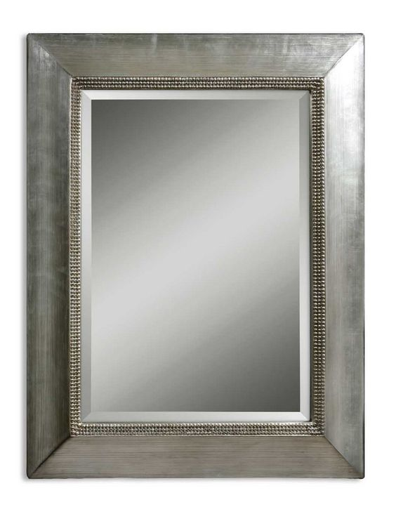 """Uttermost Fresno Antique Silver Mirror This smooth profile frame has an antiqued scratched silver leaf Finish accented with black dry brushing. Inner lip has a beaded design. Mirror features a generous 1 1/4"""" bevel. May be hung either horizontal or vertical Uttermost's mirrors combine premium quality materials with unique high-style design."""
